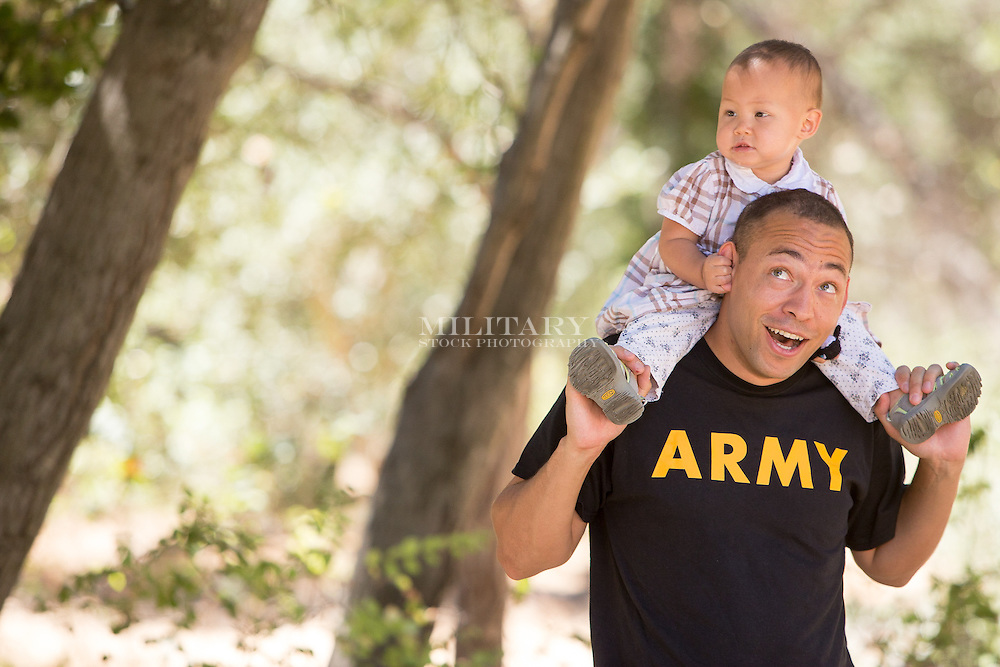 Soldier with baby daughter, model-released.  Stock photograph by Hans Halberstadt.  Reproduction requires written permission from Hans Halberstadt, Military Stock Photography, or designated representative