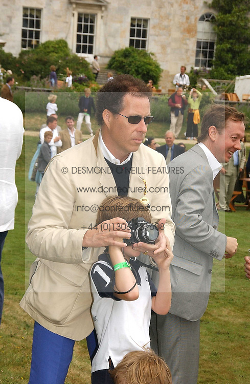 LORD LINLEY teaching his son the HON.CHARLES ARMSTRONG-JONES how to take photographs at the Goodwood Festival of Speed on 9th July 2006.  Cartier sponsored the &quot;Style Et Luxe' for vintage cars on the final day of this annual event at Goodwood House, West Sussex and hosted a lunch.<br />