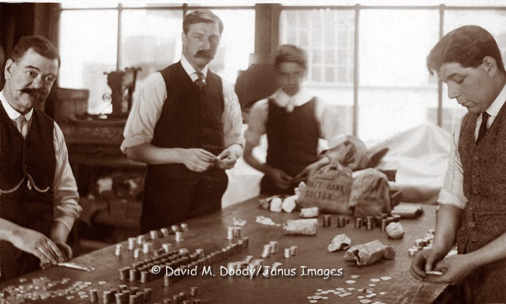 Men counting money at a bank. circa 1915