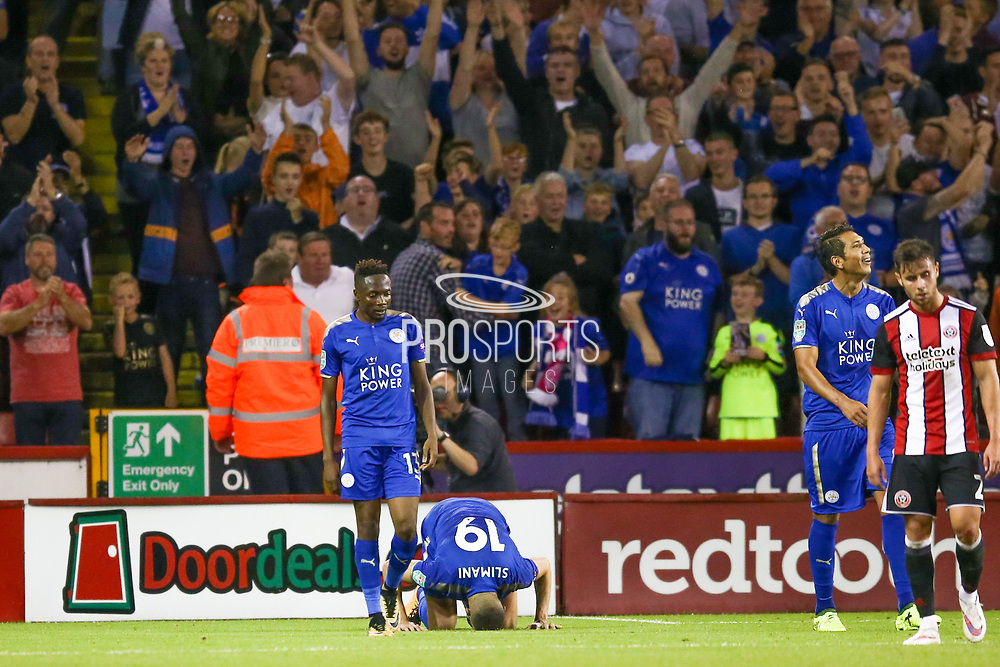 Leicester City forward Islam Slimani (19) scores a goal and celebrates by kissing the pitch to make the score 0-3 during the EFL Cup match between Sheffield Utd and Leicester City at Bramall Lane, Sheffield, England on 22 August 2017. Photo by Simon Davies.
