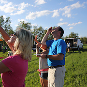 Support crew check wind speed and direction around rural Michigan near Battle Creek during the World Hot Air Ballooning Championships. Battle Creek, Michigan, USA. 20th August 2012. Photo Tim Clayton