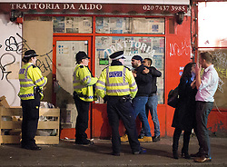 © Licensed to London News Pictures. 16/12/2016. LONDON, UK. A partygoer confronts police officers during a night out in central London on Mad Friday, the last Friday before Christmas in the UK, which marks the start of the festive party season as many offices close for the holidays.  Photo credit: ISABEL INFANTES/LNP