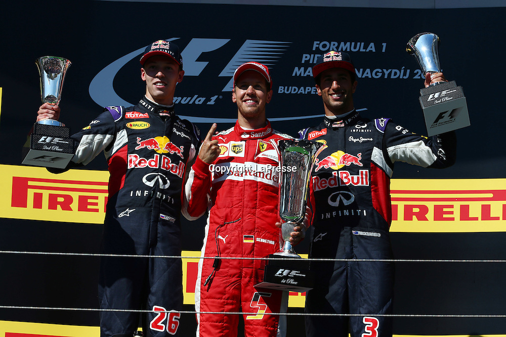 &copy; Photo4 / LaPresse<br /> 26/07/2015 Budapest, Hungary<br /> Sport <br /> Grand Prix Formula One Hungary 2015<br /> In the pic podium:<br /> 1st position Sebastian Vettel (GER) Scuderia Ferrari SF15-T <br /> 2nd position Daniil Kvyat (RUS) Red Bull Racing RB11 <br /> 3rd position Daniel Ricciardo (AUS) Red Bull Racing RB11