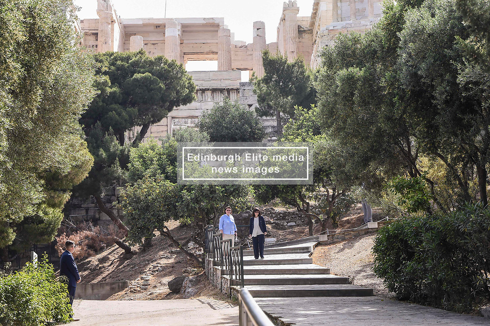 Pictured: president Sakelaropoulou Aikarerini (right) visits the Acropolis<br /> The ancient Acropolis in Athens has reopened to the public today.  The vast site has restricted visitor numbers to 2,000 to enable appropriate social distancing to be in operation. It is noticable that all staff are wearing marks the visitors are not.<br /> <br /> Dimitris Lampropoulos  | EEm 18 May 2020