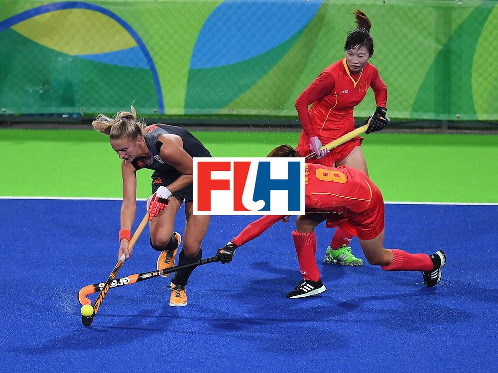 Netherland's Laurien Leurink (L) tries to get past China's Yu Qian (C), and Sun Xiao during the women's field hockey China vs Netherlands match of the Rio 2016 Olympics Games at the Olympic Hockey Centre in Rio de Janeiro on August, 10 2016. / AFP / MANAN VATSYAYANA        (Photo credit should read MANAN VATSYAYANA/AFP/Getty Images)