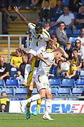 Lucas Akins (10) of Burton Albion wins a header during the EFL Sky Bet League 1 match between Oxford United and Burton Albion at the Kassam Stadium, Oxford, England on 25 August 2018.