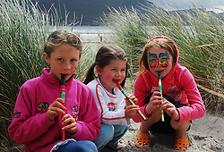 Jessica and Roisin Owens from Skerries Co Dublin pictured on Keel beach getting some practice in before the Tin Whistle world record attempt...Pic Conor McKeown