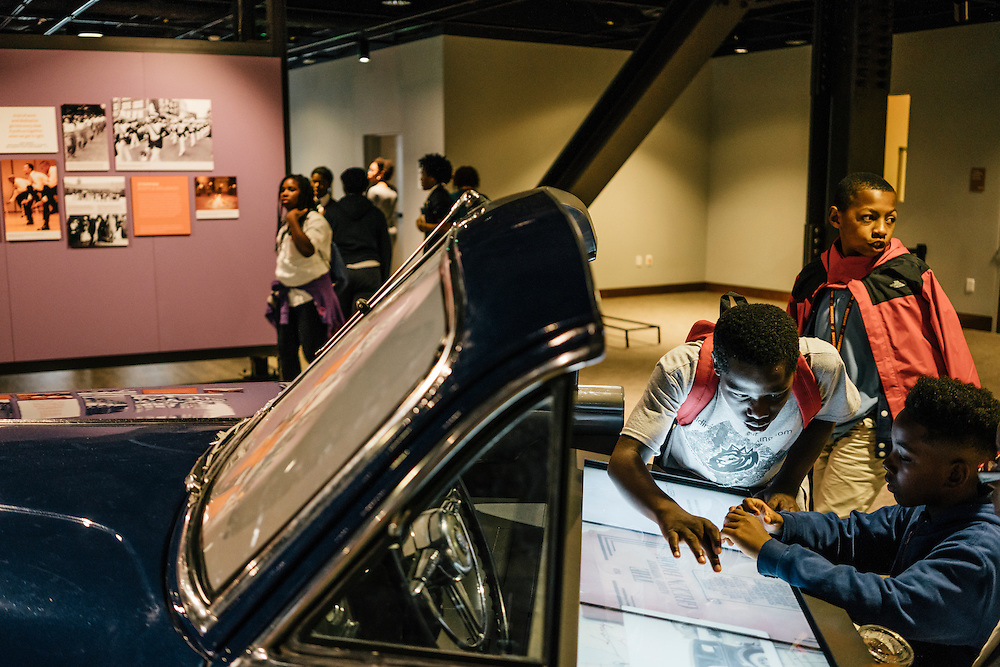 Sixth-graders from Knowledge Is Power Program (KIPP) DC, including Tay'sean Barrow, 12, center, and Tyrone Proctor, 11, right, look at exhibits inside the Smithsonian National Musuem of African American History and Culture during their visit on Oct 21, 2016. The students spent an hour touring the new Washington, D.C. museum, which is only available to see with reserved tickets during the first year.