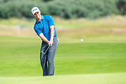 Calum Hill (SCO) plays his second shot to the 14th green during the final round of the Aberdeen Standard Investments Scottish Open at The Renaissance Club, North Berwick, Scotland on 14 July 2019.