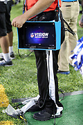 A sideline official holds a replay tablet during the Dallas Cowboys 2017 NFL Pro Football Hall of Fame preseason football game against the Arizona Cardinals on Thursday, Aug. 3, 2017 in Canton, Ohio. The Cowboys won the game 20-18. (©Paul Anthony Spinelli)