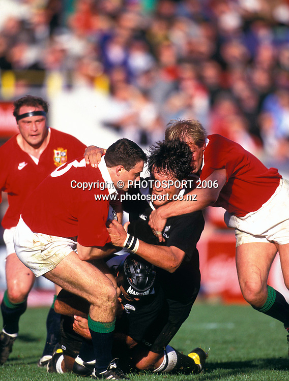 NZ Maori No.8 Zinzan Brooke is tackled during the 1993 British and Irish Lions tour to New Zealand. Photo: PHOTOSPORT<br /> New Zealand Maori v British &amp; Irish Lions at Wellington, 29 May 1993.
