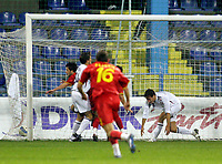 Fotball , 26.03.2008 <br /> Montenegro - Norge<br /> first goal Igor Burzanovic (L) Montenegro near Tore Reginiussen (R) Norway<br /> Foto: Digitalsport