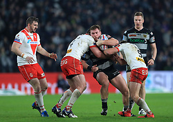 St Helens' Luke Douglas (left) and James Roby tackle Hull FC's Scott Taylor during the Betfred Super League match at the KCOM Stadium, Hull.