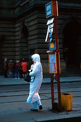 CZECH REPUBLIC BOHEMIA PRAGUE FEB00 -  A woman dressed in snow white stands at a tram stop in front of the Old National Theatre in Narodni Street. jre/Photo by Jiri Rezac. . © Jiri Rezac 2000. . Tel:   +44 (0) 7050 110 417. Email: info@jirirezac.com. Web:   www.jirirezac.com