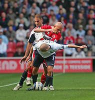 Photo: Andrew Unwin.<br />Middlesbrough v West Ham United. The Barclays Premiership. 17/04/2006.<br />West Ham look to stop Middlesbrough's Massimo Maccarone.