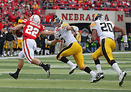November 25, 2011: Nebraska Cornhuskers running back Rex Burkhead (22) tries to hold off Iowa Hawkeyes defensive back Tanner Miller (5) during the first half of the NCAA football game between the Iowa Hawkeyes and the Nebraska Cornhuskers at Memorial Stadium in Lincoln, Nebraska on Friday, November 25, 2011. Nebraska defeated Iowa 20-7.