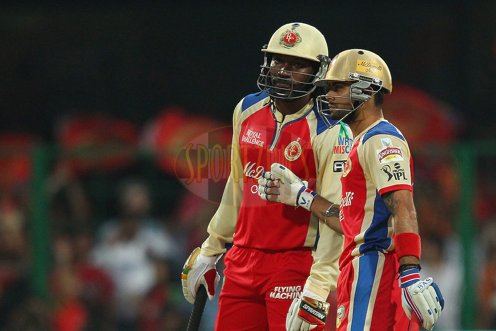 Chris Gayle and Virat Kohli during match 12 of the Pepsi Indian Premier League between The Royal Challengers Bangalore and The Kolkata Knight Riders  held at the M. Chinnaswamy Stadium, Bengaluru  on the 11th April 2013..Photo by Ron Gaunt-IPL-SPORTZPICS   ..Use of this image is subject to the terms and conditions as outlined by the BCCI. These terms can be found by following this link:..http://www.sportzpics.co.za/image/I0000SoRagM2cIEc