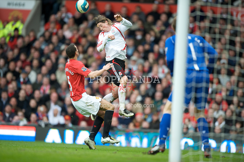 MANCHESTER, ENGLAND - Sunday, March 23, 2008: Liverpool's Fernando Torres and Manchester United's Rio Ferdinand during the Premiership match at Old Trafford. (Photo by David Rawcliffe/Propaganda)