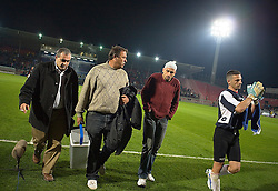 An injured Abbas Suan walks with team coaches and players from his local team B'nei Sahknin, Jaffa, Israel, Jan. 29, 2006. He was ejected from the game after having a foul called on him at Bloomfield Stadium. One his assistant coaches commented that they are never sure the injuries Abbas sustains during matches are unintentional. His team has a mixture of Israeli-Arab, Israeli, and foreign players. Suan, an Israeli-Arab, still faces criticism and racism resulting from the unsettled conflict between the Israelis and Palestinians.