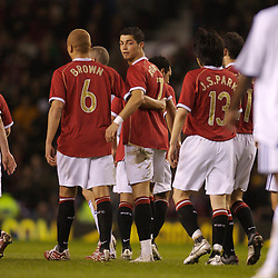 Manchester, England - Tuesday, March 13, 2007: Manchester United's Christiano Ronaldo celebrates scoring the third goal a from free kick against Europe XI, with his team-mates, during the UEFA Celebration Match at Old Trafford. (Pic by David Rawcliffe/Propaganda)