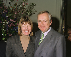 MR & MRS MARTYN LEWIS, he is the BBC Newsreader, at a reception in London on April 9th 1997.LXN 57
