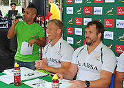 CAPE TOWN, SOUTH AFRICA - OCTOBER 15 2015, Carl Wastie (MC) with Kyle Brown and Frankie Horne during the Springbok 7's Try Dive competition at the University of Cape Town's Jameson Plaza for the Cape Town 7s taking place at Cape Town Stadium on12&amp;13 December 2015.<br /> Photo by Roger Sedres/ImageSA