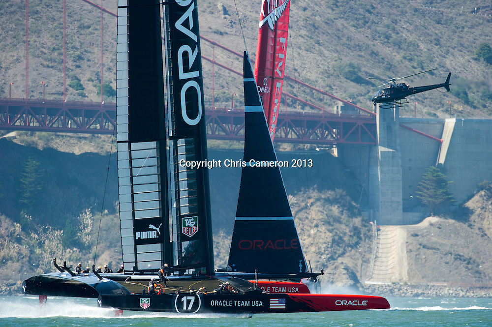 Oracle Team USA and Emirates Team New Zealand enter the start box for race 17.  America's Cup 34. 24/9/2013