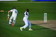 Warwickshire's Chris Woakes runs back to his crease as Hampshire's Fidel Edwards attempts to run him out during the Specsavers County Champ Div 1 match between Hampshire County Cricket Club and Warwickshire County Cricket Club at the Ageas Bowl, Southampton, United Kingdom on 12 April 2016. Photo by Graham Hunt.