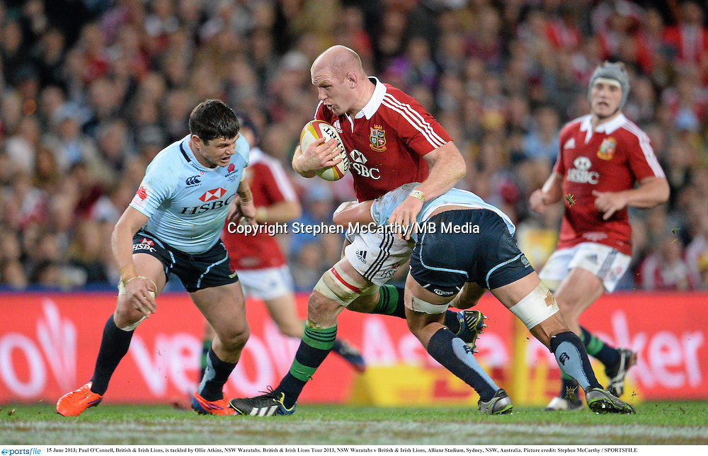 15 June 2013; Paul O'Connell, British & Irish Lions, is tackled by Ollie Atkins, NSW Waratahs. British & Irish Lions Tour 2013, NSW Waratahs v British & Irish Lions, Allianz Stadium, Sydney, NSW, Australia. Picture credit: Stephen McCarthy / SPORTSFILE