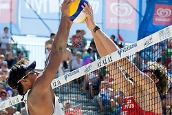 Ball over the net in blocked by Ricardo Costa Santos of Brazil and Matt Fuerbringer of USA at A1 Beach Volleyball Grand Slam tournament of Swatch FIVB World Tour 2010, semifinal, on August 1, 2010 in Klagenfurt, Austria. (Photo by Matic Klansek Velej / Sportida)