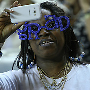 Family and friends comprised of 186 students take photos during Howard High School of Technology 146th commencement exercises Thursday, June 04, 2015, at The Bob Carpenter Sports Convocation Center in Newark, Delaware.