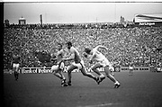 The All Ireland Senior Football Final.1982.19.09.1982.09.19.1982.19th September 1982..The senior final was contested between Offaly and Kerry. Offaly won the title by the narrowest of margins 1.15 to 17 points..Eoin Liston surges through the middle of thr park pursued by Liam O'Connor