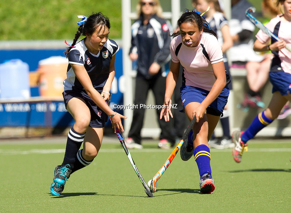 Isobella Ng (L) of Auckland chases the ball with Tiana Mativa-Horn of the Bay of Plenty during the Collier Trophy Hockey Final hockey match between Auckland v Bay of Plenty at the National Hockey Stadium in Wellington on Saturday the 12th of October 2013.  Photo by Marty Melville/www.photosport.co.nzIsobella Ng (L) of Auckland chases the ball with Tiana Mativa-Horn of the Bay of Plenty during the Collier Trophy Hockey Final hockey match between Auckland v Bay of Plenty at the National Hockey Stadium in Wellington on Saturday the 12th of October 2013.  Photo by Marty Melville/www.photosport.co.nz