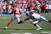 Kansas City Chiefs defensive back Ron Parker (38) looks to avoid a diving tackle attempt by Los Angeles Chargers offensive guard Michael Schofield III (75) as he runs with the ball after intercepting a third quarter pass that stops a Los Angeles Chargers drive and gives the Chiefs the ball at their 14 yard line during the 2018 regular season week 1 NFL football game against the Los Angeles Chargers on Sunday, Sept. 9, 2018 in Carson, Calif. The Chiefs won the game 38-28. (©Paul Anthony Spinelli)