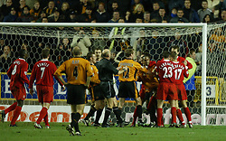 WOLVERHAMPTON, ENGLAND - Wednesday, January 21st, 2004: Wolverhampton Wanderers' Paul Ince is held back by Liverpool's Steve Finnan after clashing with Steven Gerrard during the Premiership match at Molineux. (Pic by David Rawcliffe/Propaganda)