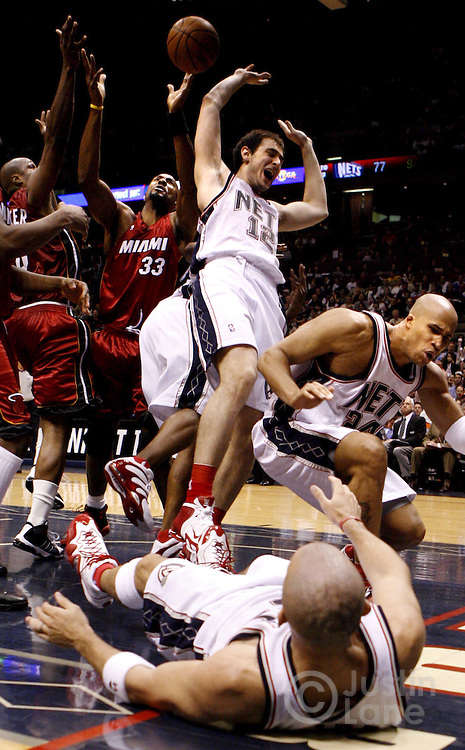 epa00712918 The Nets' Jason Kidd (foreground on floor), Richard Jefferson (R), and Nenad Krstic (C) collide while the Heat's Alonzo Mourning (2nd from L) and Antoine Walker (L) grab a rebound during the Miami Heat's 102- 92 victory over the New Jersey Nets in game four of the round two playoffs at Continental Airlines Arena in East Rutherford, New Jersey on Sunday 14 May 2006.  EPA/JUSTIN LANE