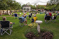 """A perfect evening to enjoy the soulful sounds of Sharon """"Sugar"""" Jones during Thursday evening's Concert by the River at Rotary Park.    (Karen Bobotas/for the Laconia Daily Sun)"""