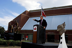 19 September 2009: Doug Collins takes a spot at the podium to make a statement after the unveiling of the statue depicting Will Robinson and himself. Illinois State University took the day to celebrate 2 of it's own, the late Will Robinson and national hero Doug Collins.  Will Robinson became the first black head basketball coach in NCAA Division I history when names ISU basketball coach in 1970.  Doug Collins was an Illinois State standout basketball player who represented the United States in the 1972 Olympics, played NBA ball for several years where he later coached and recently recieved the Curt Gowdy Media Award for career in broadcasting.  A statue was erected in their honor on the terrace just north of the main entrance to Redbird Arena on ISU's campus in Normal IL