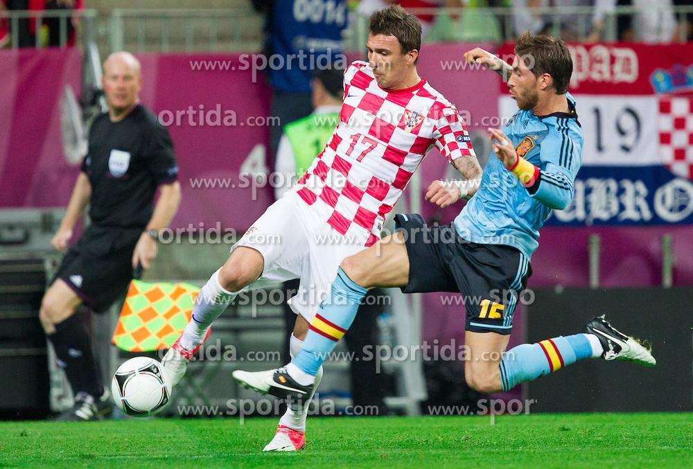 Mario Mandzukic of Croatia vs Sergio Ramos of Spain during the UEFA EURO 2012 group C match between  Croatia and Spain at PGE Arena Gdansk on June 18, 2012 in Gdansk / Danzig, Poland. (Photo by Vid Ponikvar / Sportida.com)