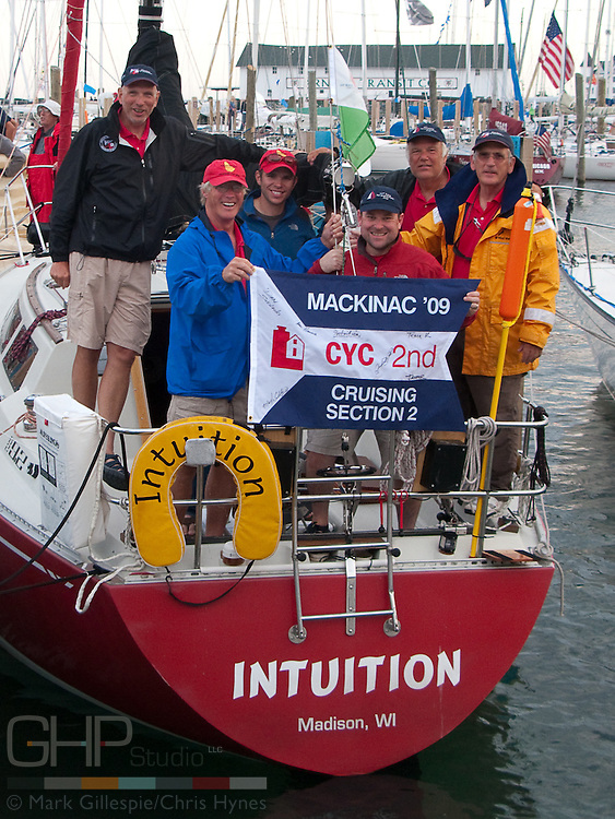 (Lt. - Rt.) Tom Kershner, Don Hanna, Andy Marin, Mark Gillespie, Dan Siedlecki, Jasper Rine abord Intuition, an S2 9.2A at Mackinac Island.