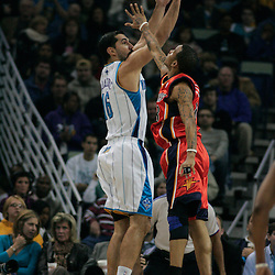 30 January 2009:  New Orleans Hornets forward Peja Stojakovic (16) shoots over Golden State Warriors guard Monta Ellis (8) during a 91-87 loss by the New Orleans Hornets to Golden State Warriors at the New Orleans Arena in New Orleans, LA.