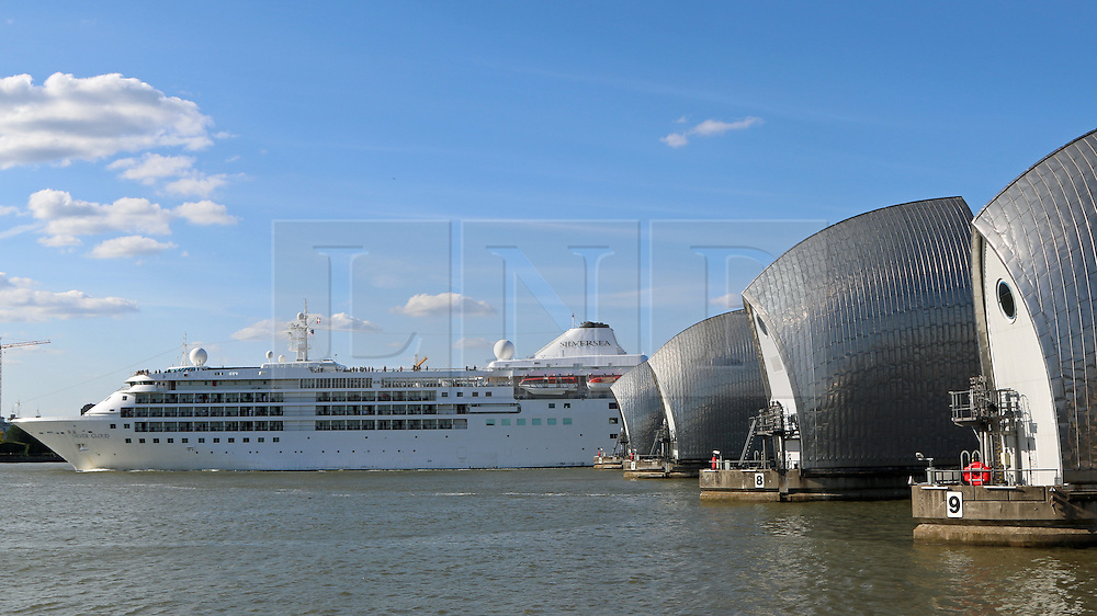 © Licensed to London News Pictures. 07/06/2015.  Woolwich, London. The cruise ship Silver Cloud has arrived in London for the first of four visits this year. The cruise ship arrived through the Thames Barrier and passed the O2 on a sunny, summer's day with temperatures thought to be over 20 degrees today. The ship continued further up river to moor alongside HMS Belfast until tomorrow (Monday) Credit : Rob Powell/LNP