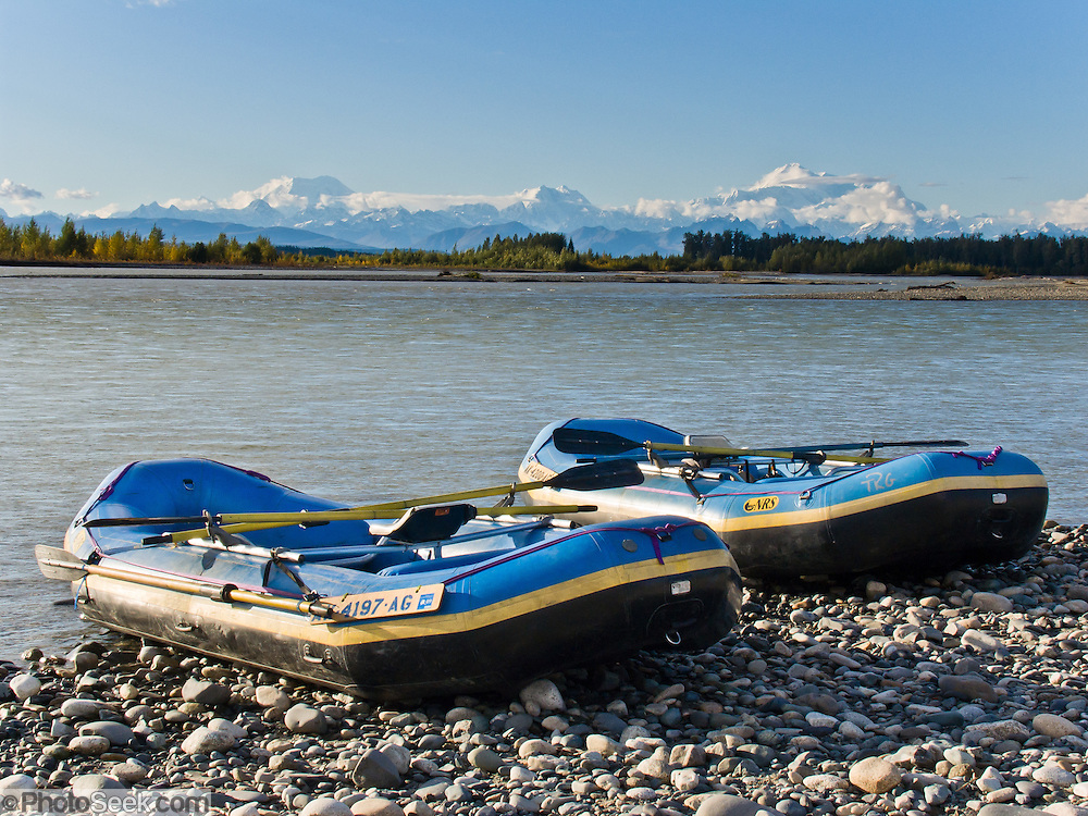 See Mount Foraker, Mount Hunter, and Mount McKinley from the confluence of the Talkeetna and Susitna Rivers at Talkeetna, Alaska, USA. Paddle a rubber raft. Denali (20,310 feet or 6191 meters, aka Mount McKinley) is the highest mountain peak in North America, and measured from base to peak, it is earth's tallest mountain on land. Mount McKinley is a granitic pluton uplifted by tectonic pressure while erosion has simultaneously stripped away the somewhat softer sedimentary rock above and around it.