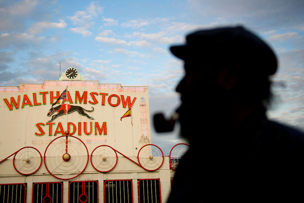 "Lifelong Walthamstow resident Jeff Harris, 65, admires the famous stadium at dusk, on the final night of racing in its 75 year history.  ""What a shame and loss for the heritage of England,"" Harris said.  Forced to close as a result of diminishing profits and poor attendance, record crowds flocked to take in the festivites one last time.  ."