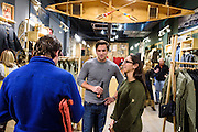 Guests mingle and look at clothing apparel and outdoor-outfitter gear during a grand opening event for Fjällräven Madison, a Swedish-heritage brand store in downtown Madison, Wis., on Oct. 22, 2015. Pictured at right is Samantha Bonizzi of Turner PR. (Photo by Jeff Miller - www.jeffmillerphotography.com)