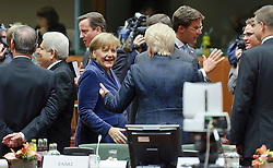 "Angela Merkel, Germany's chancellor, center, greets Dalia Grybauskaite, Lithuania's president,  as she arrives for an emergency EU Summit to solve Europe's debt crisis at the European Council headquarters in Brussels, Belgium, on Wednesday, Oct. 26, 2011. ""The world is watching Europe and Germany,"" Germany's Chancellor Angela Merkel said in a speech today to the lower house in Berlin, the Bundestag. (Photo © Jock Fistick)"