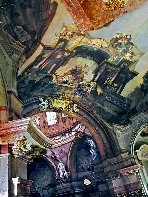 Prague, St. Nicholas church interior, looking up near the crossing.  Exuberant High Baroque frescoes, sculptures, pilasters, and arches make an impossible composition.  Early 18th century.  Architect Krystof Dienzenhofer.  Frescoes painted by Viennese artist Jan Lukas Kracker, as well as several other painters and sculptors