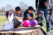 (Left to Right) Mu-Tse, Mu-Cheng, and Mu-Shih Yu celebrate their Easter egg prizes during  the 21st Annual Easter Egg Hunt at Winnequah Park in Monona, WI on Saturday, April 20, 2019.