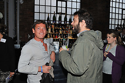 Left to right, SID OWEN and SIMON KONECKI at a party to celebrate the Kelly Hoppen and Smallbone kitchen range held at The Collection, 264 Brompton Road, London on 24th September 2012.