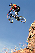 Steve Peat jumps off a Virgin Utah cliff in the 2002 Red Bull Rampage freeride mountain bike contest